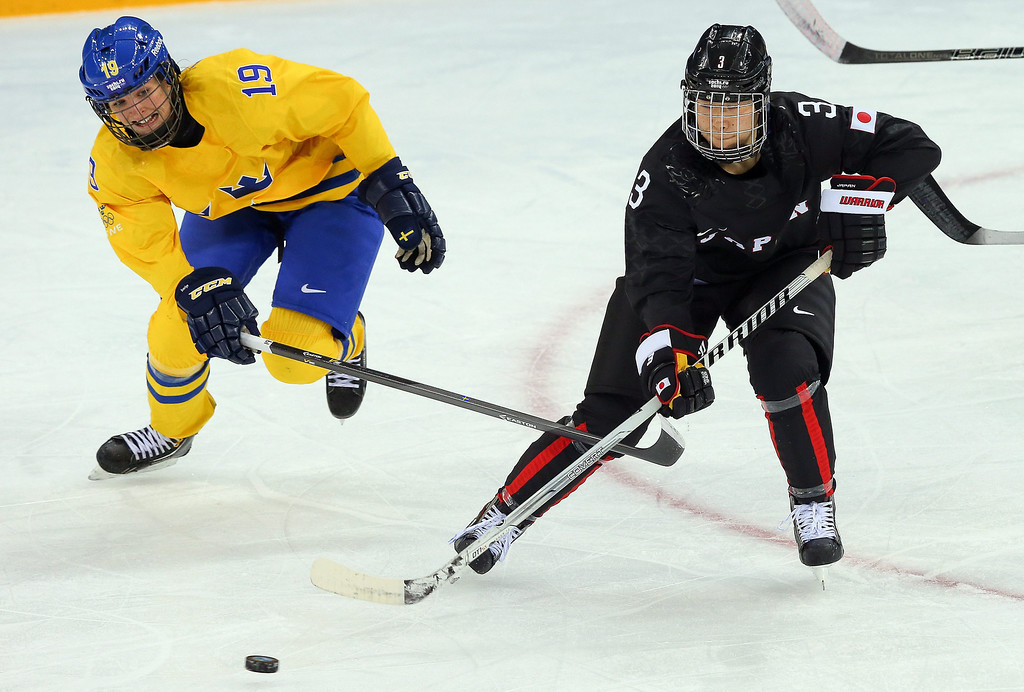 . Yoko Kondo (R) of Japan in action against Maria Lindh (L) of Sweden during the match between Sweden and Japan at the Shayba Arena in the Ice Hockey tournament at the Sochi 2014 Olympic Games, Sochi, Russia, 09 February 2014  EPA/SRDJAN SUKI