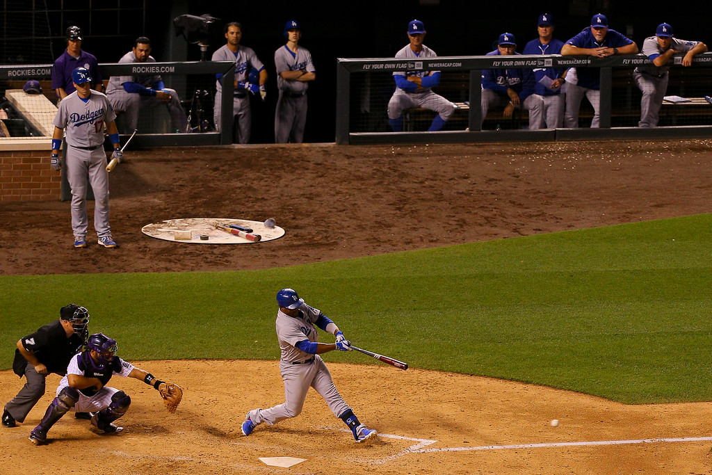 . Juan Uribe #5 of the Los Angeles Dodgers hits the eventual game winning RBI single during the ninth inning against the Colorado Rockies at Coors Field on July 3, 2014 in Denver, Colorado. The Dodgers defeated the Rockies 3-2. (Photo by Justin Edmonds/Getty Images)
