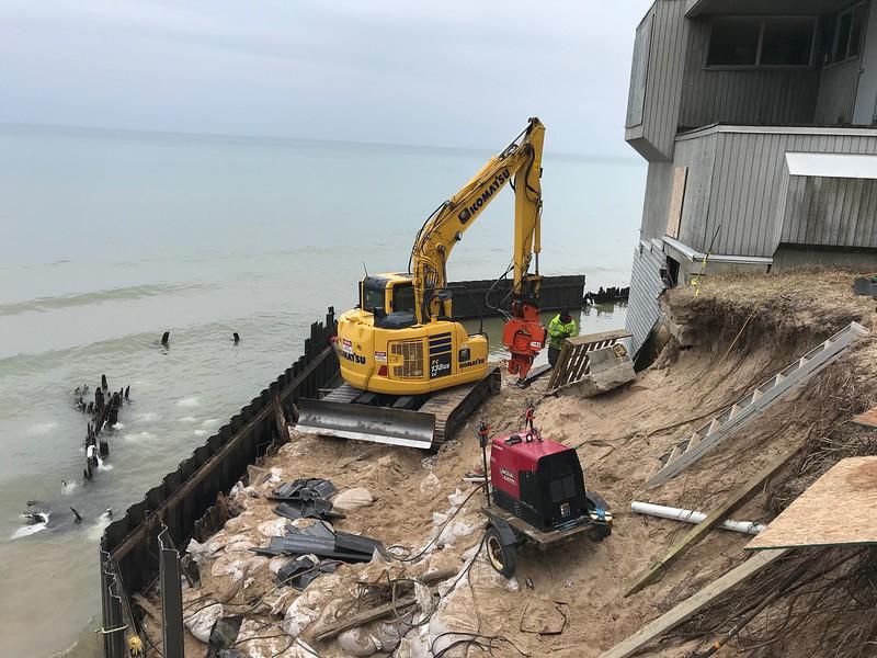NPK C6CSD on Komatsu PC138 - Saving houses from high water beach erosion on Lake Michigan Mar2020 (6).jpg