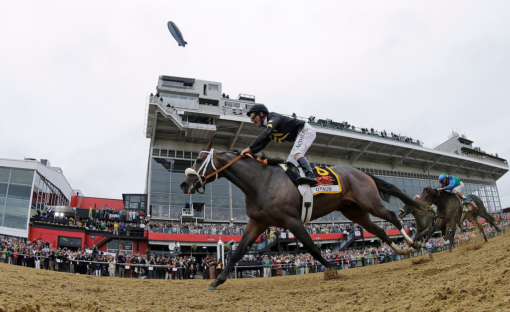 . Oxbow, ridden by jockey Gary Stevens, wins the 138th Preakness Stakes horse race at Pimlico Race Course, Saturday, May 18, 2013, in Baltimore. (AP Photo/Matt Slocum)
