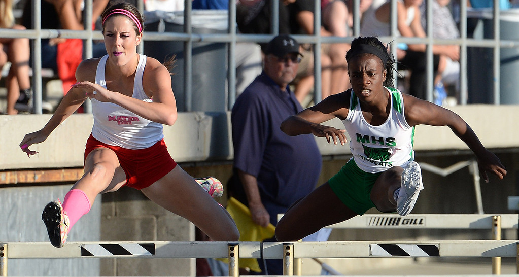. Monrovia\'s Syndey Mosley, right, along with Mater Dei\'s Emma Radan competes in the 100 meter hurdles during the CIF-SS Masters Track and Field meet at Falcon Field on the campus of Cerritos College in Norwalk, Calif., on Friday, May 30, 2014.   (Keith Birmingham/Pasadena Star-News)
