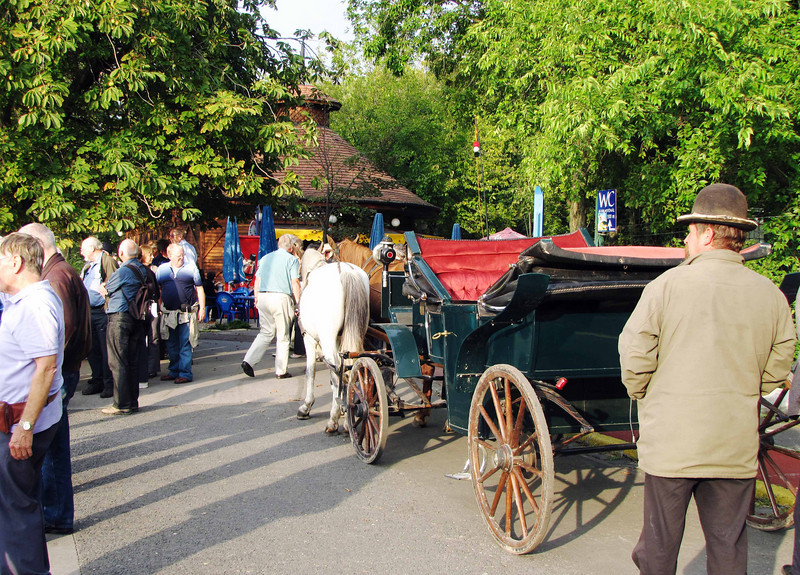 43-Carriages and drivers gather near the boat dock, looking for passengers