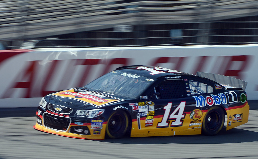 . (Will Lester/Staff Photographer) NASCAR driver Tony Stewart races down the front straightaway during the opening practice session for Sunday\'s Auto Club 400 Friday March 22, 2013.