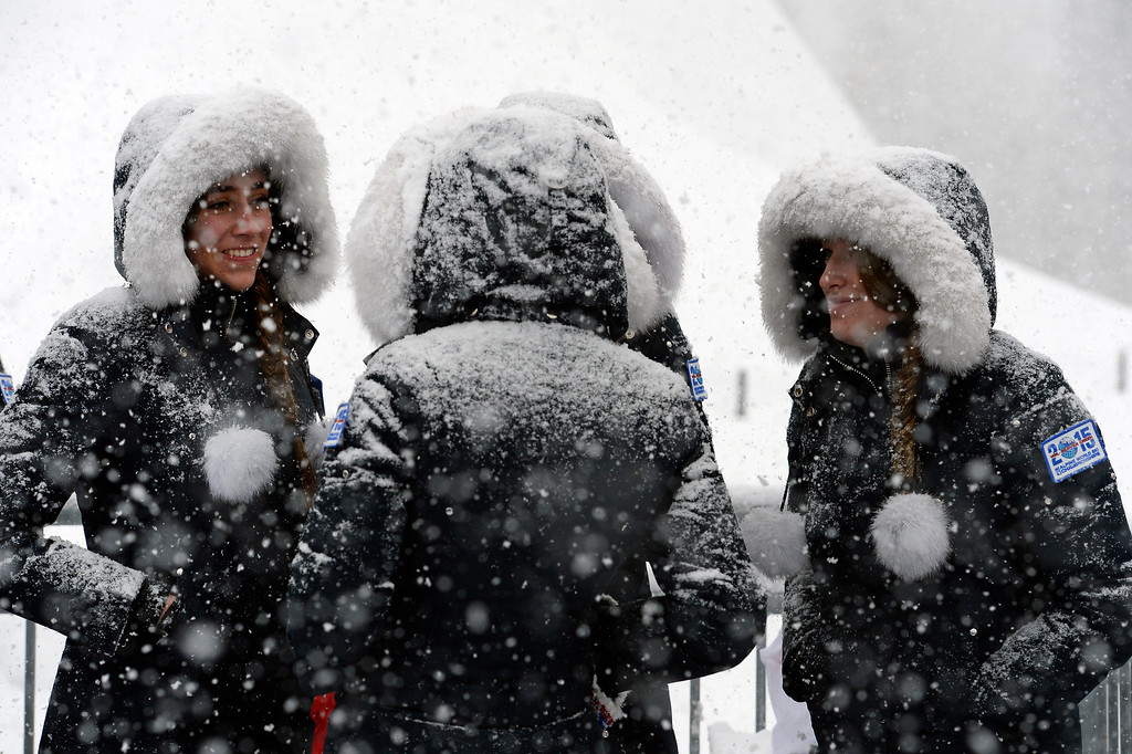 . BEAVER CREEK, CO - FEBRUARY 15: Flower girls wait in the heavy snow before the medal ceremony to take place after the Men\'s Slalom at the FIS Alpine World Ski Championships in Beaver Creek, CO on February 15, 2015. (Photo By Helen H. Richardson/The Denver Post)