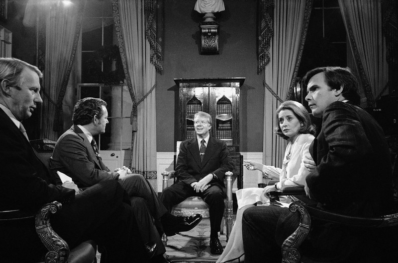 . President Jimmy Carter is interviewed by four television reporters on Wednesday, Dec. 28, 1977 in the Red Room of the White House at Washington.  From left are: Bob McNeil, PBS; Bob Schieffer, CBS; Carter; Barbara Walters, ABC; and Tom Brokaw, NBA. (AP Photo/Charles Tasnadi)