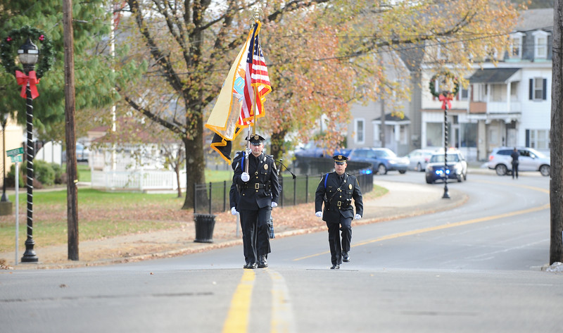 """The Phillipsburg Police Honor Guard carries the Colors across the bridge. Phillipsburg Police Department held a remembrance ceremony honoring fallen officer, Kenneth W. """"Red"""" Vandegrift who died in the line of duty Nov. 20, 1930. The ceremony was at the bridge on South Main Street that bears his name."""