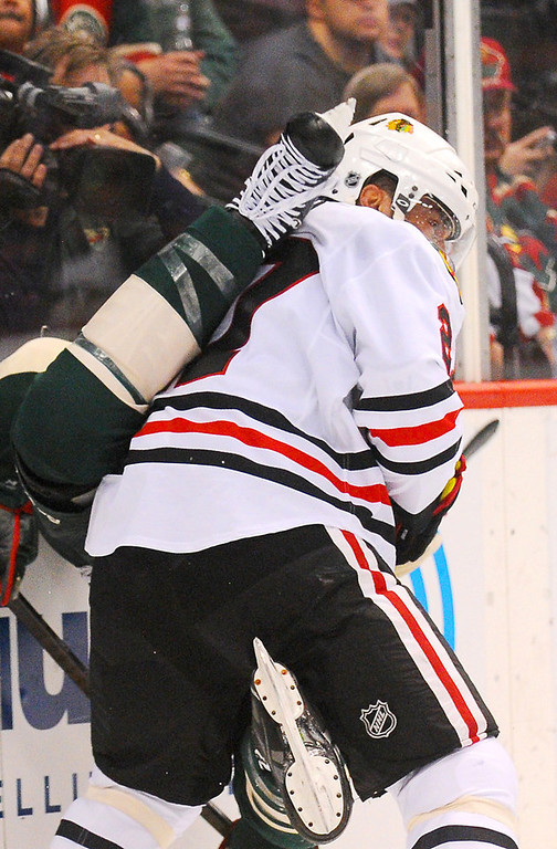 . Chicago defenseman Johnny Oduya gets a skate to the back after he shoves Minnesota right wing Charlie Coyle to the ice in the second period. (Pioneer Press: John Autey)