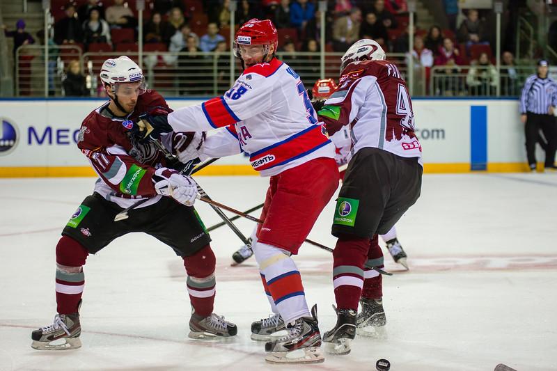 Martins Porejs (77) tries to stop Kozlov Viktor (38)