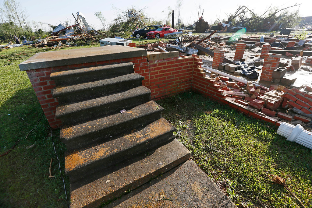 . A set of front door steps are all that remain of a house that was blown off its foundation by Monday\'s tornado in Louisville, Miss., Tuesday, April 29, 2014.  (AP Photo/Rogelio V. Solis)