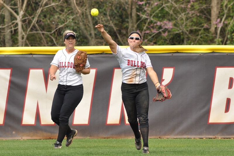 Melinda Dulkowski throws in vs UNC Greensboro on March 22, 2012.