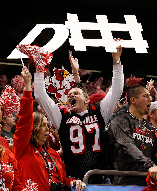 . Louisville fans react in the first half of the Sugar Bowl NCAA college football game against Florida on Wednesday, Jan. 2, 2013, in New Orleans. (AP Photo/Bill Haber)