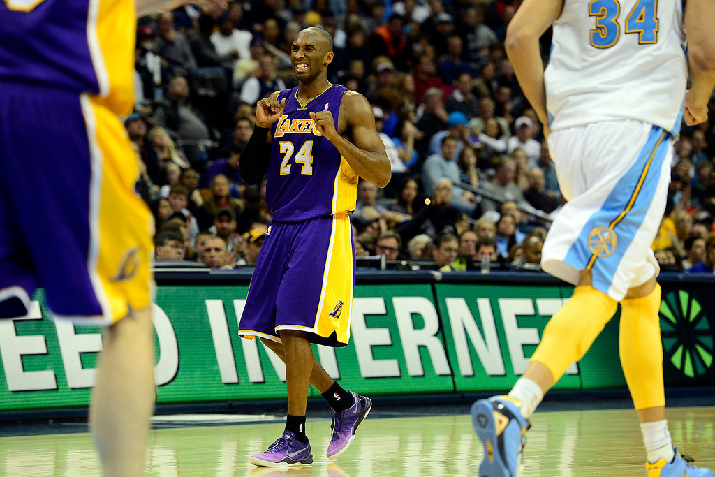 . Los Angeles Lakers shooting guard Kobe Bryant (24) reacts a turnover against the Denver Nuggets during the second half of the Nuggets\' 126-114 win at the Pepsi Center on Wednesday, December 26, 2012. AAron Ontiveroz, The Denver Post
