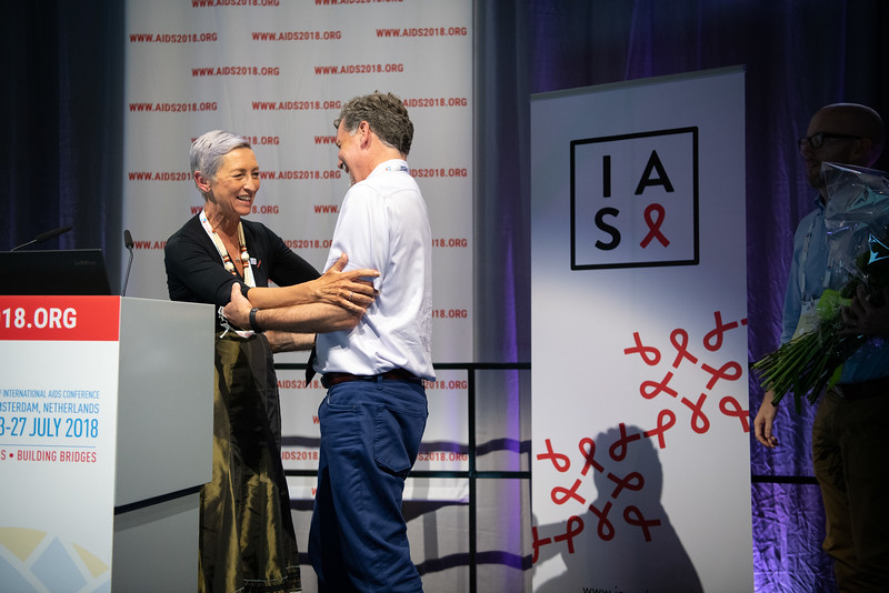 22nd International AIDS Conference (AIDS 2018) Amsterdam, Netherlands.   Copyright: Steve Forrest/Workers' Photos/ IAS  Photo shows: President of the IAS, Linda-Gail Bekker presenting flowers to Immediate Past President, Chris Beyrer, during the IAS Members' Meeting.