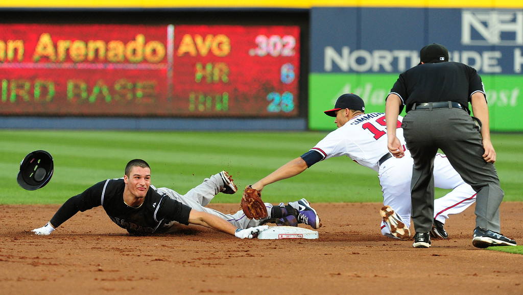 . ATLANTA, GA - MAY 23: Nolan Arenado #28 of the Colorado Rockies dives in to second base safely during the 2nd inning against Andrelton Simmons #19 of the Atlanta Braves at Turner Field on May 23, 2014 in Atlanta, Georgia. (Photo by Scott Cunningham/Getty Images)