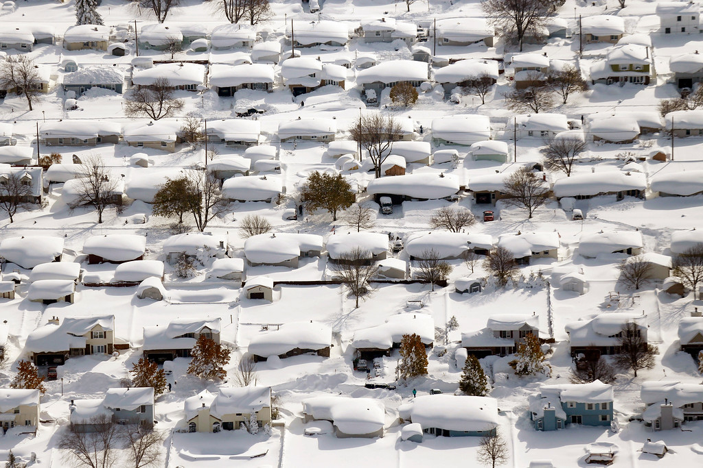. Homes are covered in snow in West Seneca, N.Y., Wednesday, Nov. 19, 2014. (AP Photo/The Buffalo News, Derek Gee)