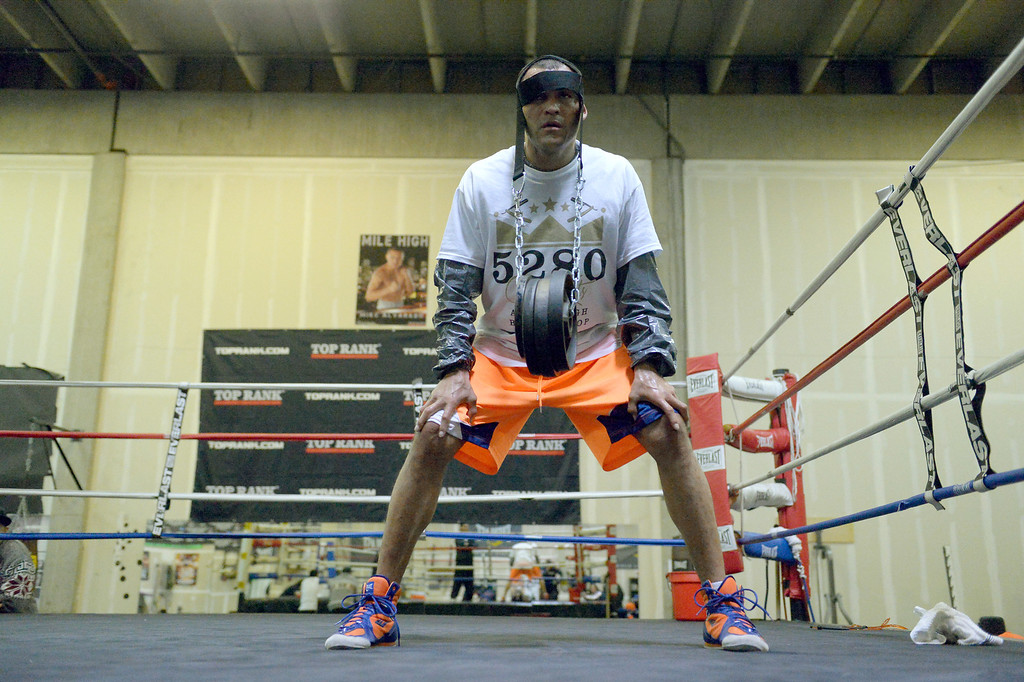 ". DENVER, CO - OCTOBER 15: Colorado\'s only reigning Champion ""Mile High\"" Mike Alvarado works on his neck with 35lb weights strapped on his head during a media workout day at Delgado\'s Gym October 15, 2013 as he gets ready for his fight with the Ruslan Provodnikov at 1st Bank Center. (Photo by John Leyba/The Denver Post)"