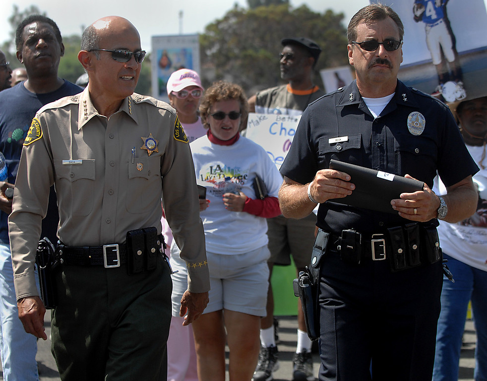 . Los Angeles County Sheriff Lee Baca, left, walks with Deputy Chief Charlie Beck of the Los Angeles Police Department during the LA Livepeace march and rally at the Los Angeles Memorial Coliseum on Saturday morning. The event aimed to promote nonviolence and awareness of gang intervention efforts in Los Angeles. (August 2, 2008)  (Los Angeles Daily News file photo)
