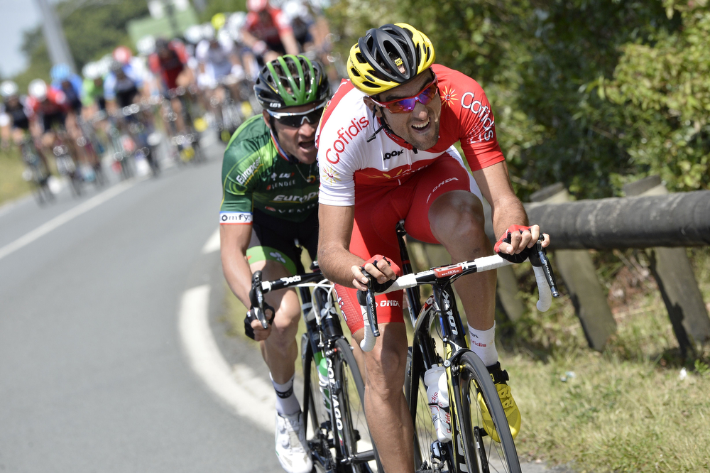 . Spain\'s Luis Angel Mate Mardones (R) and France\'s Thomas Voeckler ride in a breakaway during the 163.5 km fourth stage of the 101st edition of the Tour de France cycling race on July 8, 2014 between Le Touquet-Paris-Plage and Lille, northern France.  (JEFF PACHOUD/AFP/Getty Images)