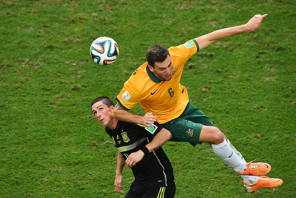 . Matthew Spiranovic of Australia challenges Fernando Torres of Spain during the 2014 FIFA World Cup Brazil Group B match between Australia and Spain at Arena da Baixada on June 23, 2014 in Curitiba, Brazil.  (Photo by David Ramos/Getty Images)