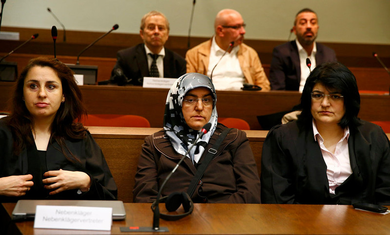 . Adile Simsek (C), widow of NSU victim Enver Simsek, sits among her lawyers in the courthouse before the start of the trial in Munich May 6, 2013. The surviving member of NSU blamed for a series of racist murders that scandalized Germany and shamed its authorities goes on trial on Monday in one of the most anticipated court cases in recent German history.        REUTERS/Michael Dalder