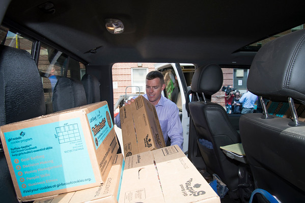 08/14/19 Wesley Bunnell | Staff Congressional candidate John Cain helps unload Girl Scout cookies from his truck at the Newington VA on Wednesday August 14, 2019. The candidate, through donations from the Girl Scouts, delivered over three thousand boxes of cookies to his fellow veteran along with the help of congressional candidate Justin Anderson and candidate for senate Robert F Hyde.