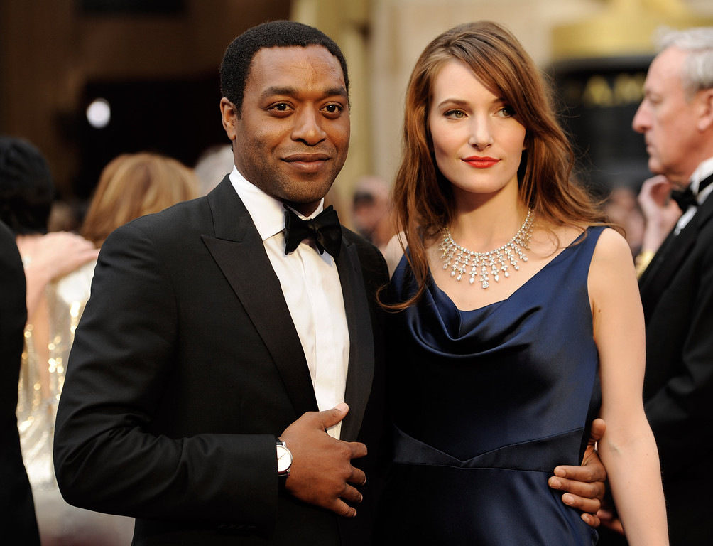 . Chiwetel Ejiofor, and Sari Mercer arrive at the Oscars on Sunday, March 2, 2014, at the Dolby Theatre in Los Angeles.  (Photo by Chris Pizzello/Invision/AP)