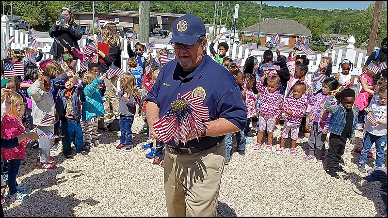 Bill Blank distributing miniature flags to all students.