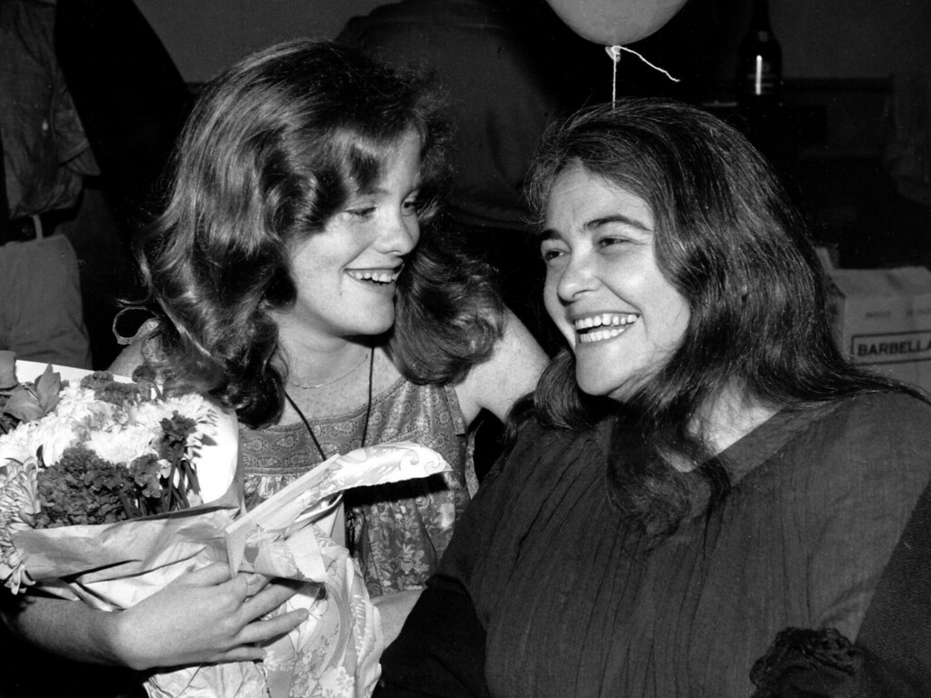 """. FILE  - In this May 21, 1979 file photo, feminist activist Kate Millett, right, laughs, during a surprise birthday party for her niece, Kristan Vigard, in New York. Millett, the activist, artist and educator whose best-selling \""""Sexual Politics\"""" was a landmark of cultural criticism and a manifesto for the modern feminist movement, has died at 82, it was reported on Thursday, Sept. 7, 2017. (AP Photo/Ron Frehm, File)"""