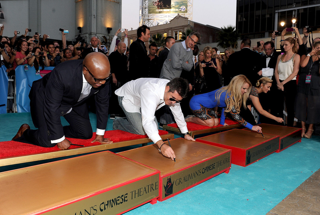 """. HOLLYWOOD, CA - SEPTEMBER 11: (L-R) Judges L.A. Reid, Simon Cowell, Britney Spears and Demi Lovato at \""""The X Factor\"""" Season 2 Premiere and handprint ceremony at Grauman\'s Chinese Theatre on September 11, 2012 in Hollywood, California. (Photo by Frank Micelotta/PictureGroup) via AP IMAGES"""