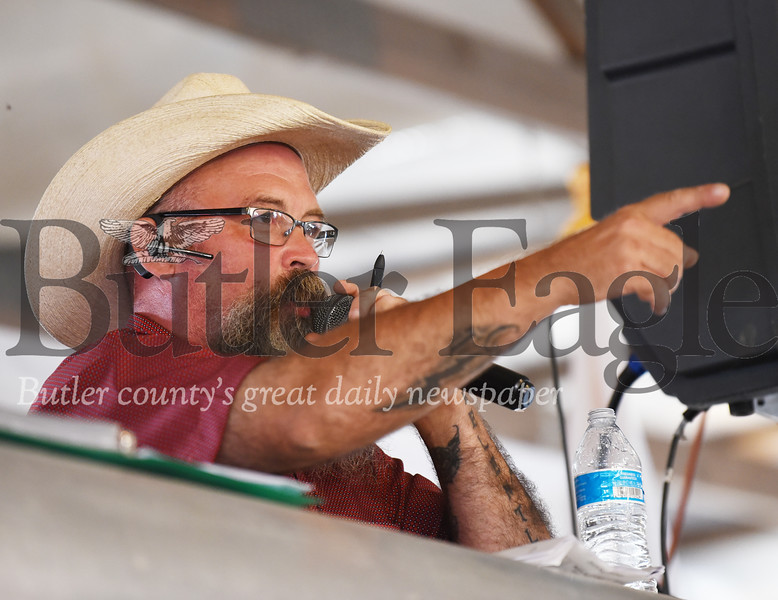 Harold Aughton/Butler Eagle: Auctioneer Roger Croll of Slippery Rock accepts a bid during the 4-H-FFA Livestock Auction at the Butler Farm Show.
