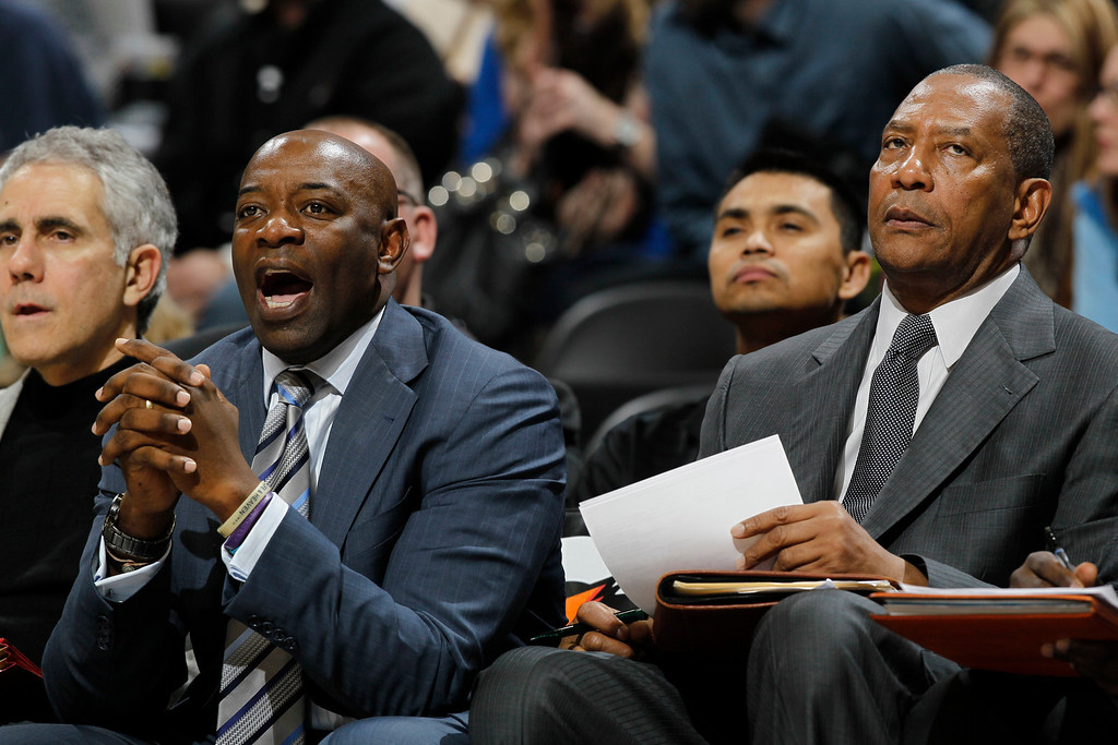 . Sacramento Kings head coach Keith Smart, left, directs his team as assistant coach Alex English looks on in the fourth quarter of the Denver Nuggets\' 121-93 victory over the Kings in an NBA basketball game in Denver on Saturday, Jan. 26, 2013. (AP Photo/David Zalubowski)