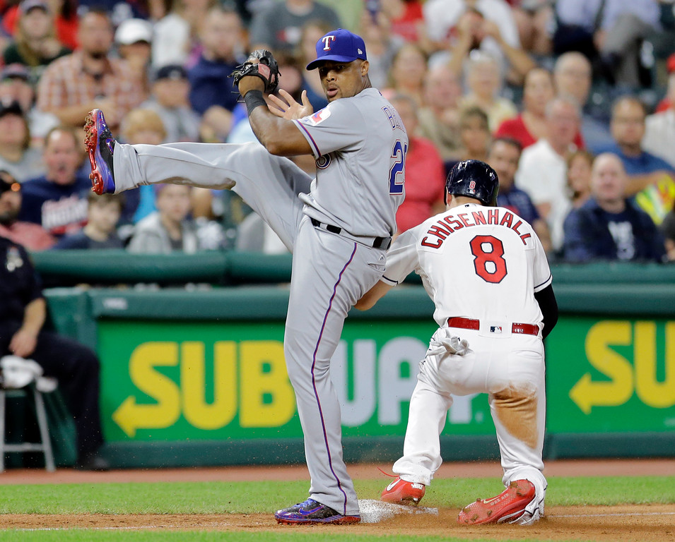 . Texas Rangers\' Adrian Beltre looks toward first base after getting Cleveland Indians\' Lonnie Chisenhall out at third base in the eighth inning of a baseball game, Wednesday, June 28, 2017, in Cleveland. Bradley Zimmer bunted into a fielder\'s choice and was safe at first base. (AP Photo/Tony Dejak)