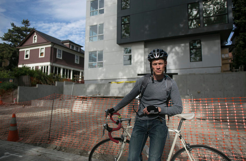 """. Carl Winter, founder of the lobby group Reasonable Density Seattle, stands in front of the aPodments Building being constructed on the 100 block of 13th Avenue E in Seattle, Washington May 11, 2013.  \""""There is a reasonable amount of density that is acceptable\"""", explained Winter.  REUTERS/Nick Adams"""