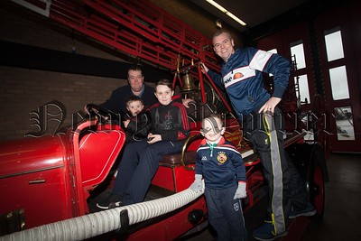 John and Johnny O'Hagan, PJ O'Hagan along with Kevin O'Connor (Sen) and Kevin O'Connor (Jun). are pictured on an old Fire Engine at the 20th Aniversary celebrations held at Newry Fire Station. R1606006