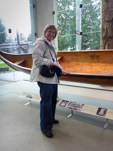 Mom checking out the craftsmanship of a dug out canoe at the UBC museum of anthropology.