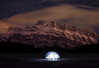 """While the Mountain Was Sleeping""<br /> <br /> Amidst the darkness of a moonless, silent night in the Rockies, while the peaks slumber under their blanket of clouds, a lonely shelter shines on...<br /> <br /> Taken last night at Two Jack Lake, Banff National Park. The north side of Mount Rundle is bathed by the glow of Banff and Canmore while the stars creep across the sky in this 2 minute exposure."
