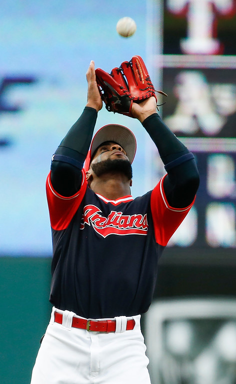 . Cleveland Indians\' Yandy Diaz makes a catch to get out Kansas City Royals\' Whit Merrifield during the first inning in a baseball game, Saturday, Aug. 26, 2017, in Cleveland. (AP Photo/Ron Schwane)