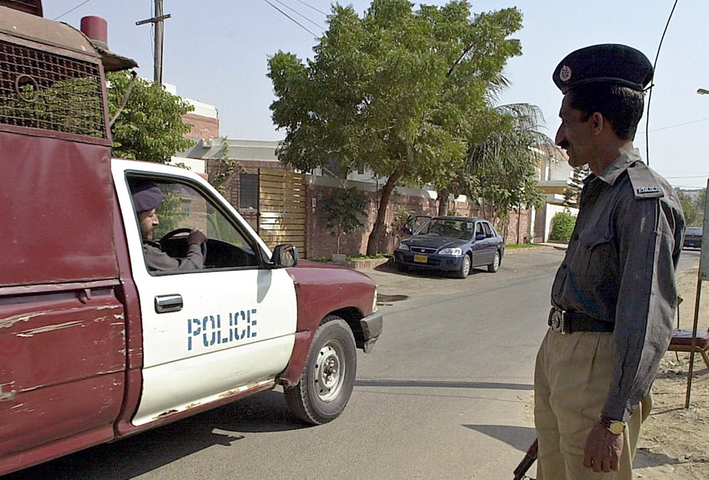 """. Police vehicle is parked before the residence of Daniel Pearl,  South Asia bureau chief of the Wall Street Journal in Karachi, Pakistan Thursday, Jan. 31, 2002. An e-mail purportedly sent by kidnapper of Pearl, who disappeared in Karachi on Jan. 23,  threatend to kill him within 24 hours and warned American journalists to leave Pakistan within three days or \'be targeted.\""""   (AP Photo/Zia Mazhar)"""