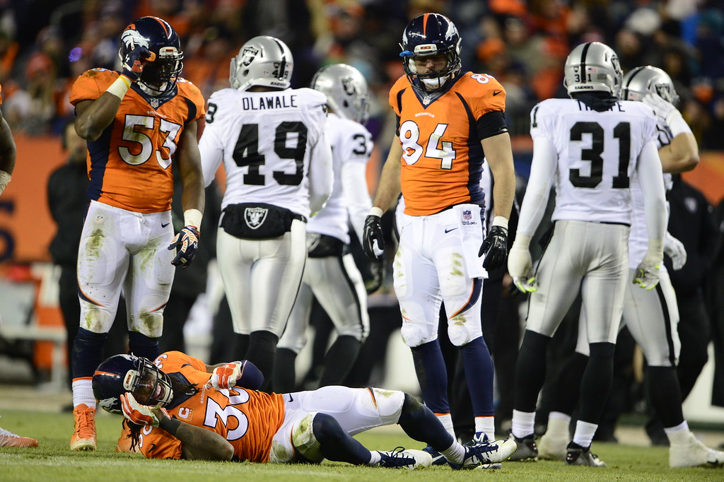 . DENVER, CO - DECEMBER 28: David Bruton (30) of the Denver Broncos on the ground after taking a hit to the back during the fourth quarter. He was taken off the field on a stretcher. The Denver Broncos played the Oakland Raiders at Sports Authority Field at Mile High in Denver on December, 28 2014. (Photo by Joe Amon/The Denver Post)