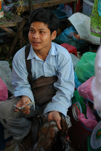 Young Man Selling Chicken - Phnom Penh, Cambodia