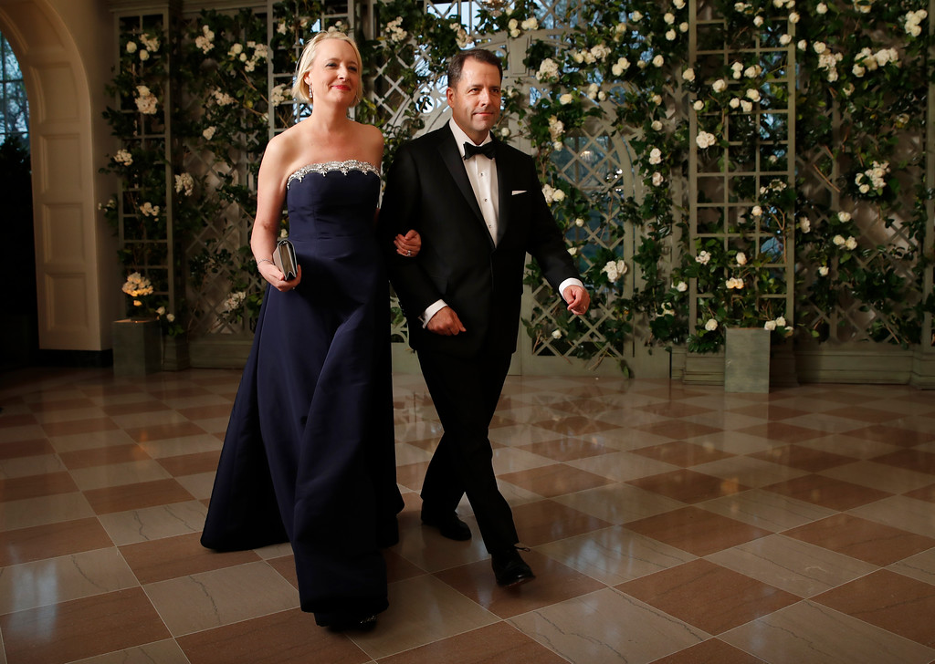 . Julie Sweet and Chad Sweet arrive for a State Dinner with French President Emmanuel Macron and President Donald Trump at the White House, Tuesday, April 24, 2018, in Washington. (AP Photo/Alex Brandon)