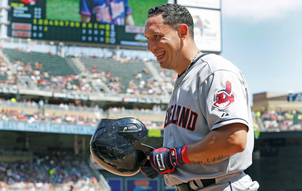 . Cleveland\'s Asdrubal Cabrera laughs as he arrives in the dugout after scoring on a two-run home run by teammate Jason Kipnis off Twins starter Scott Diamond in the third inning. (AP Photo/Jim Mone)