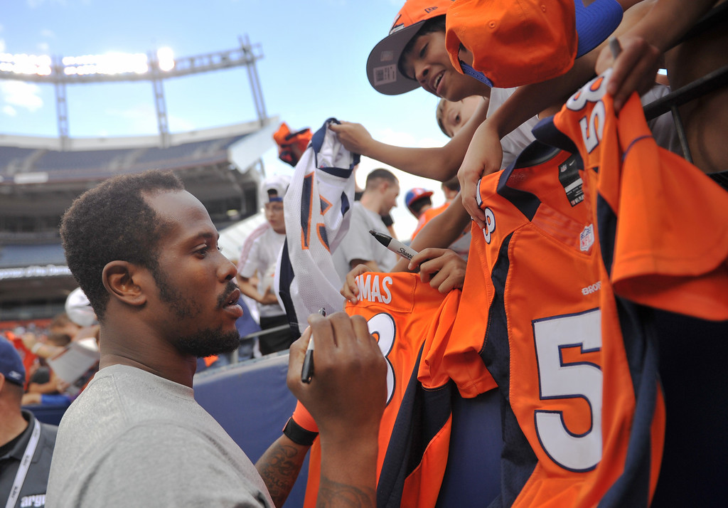 . DENVER, CO. - August 03: Von Miller of Denver Broncos (58) sign autograph for the fans at Sports Authority Field at Mile High. Denver, Colorado. August 03, 2013. (Photo By Hyoung Chang/The Denver Post)