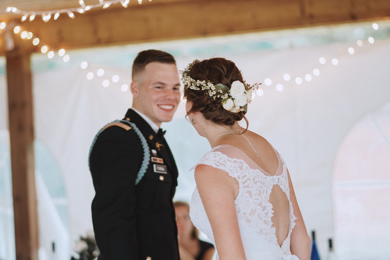 The bride looks at the groom as he smiles back at her.