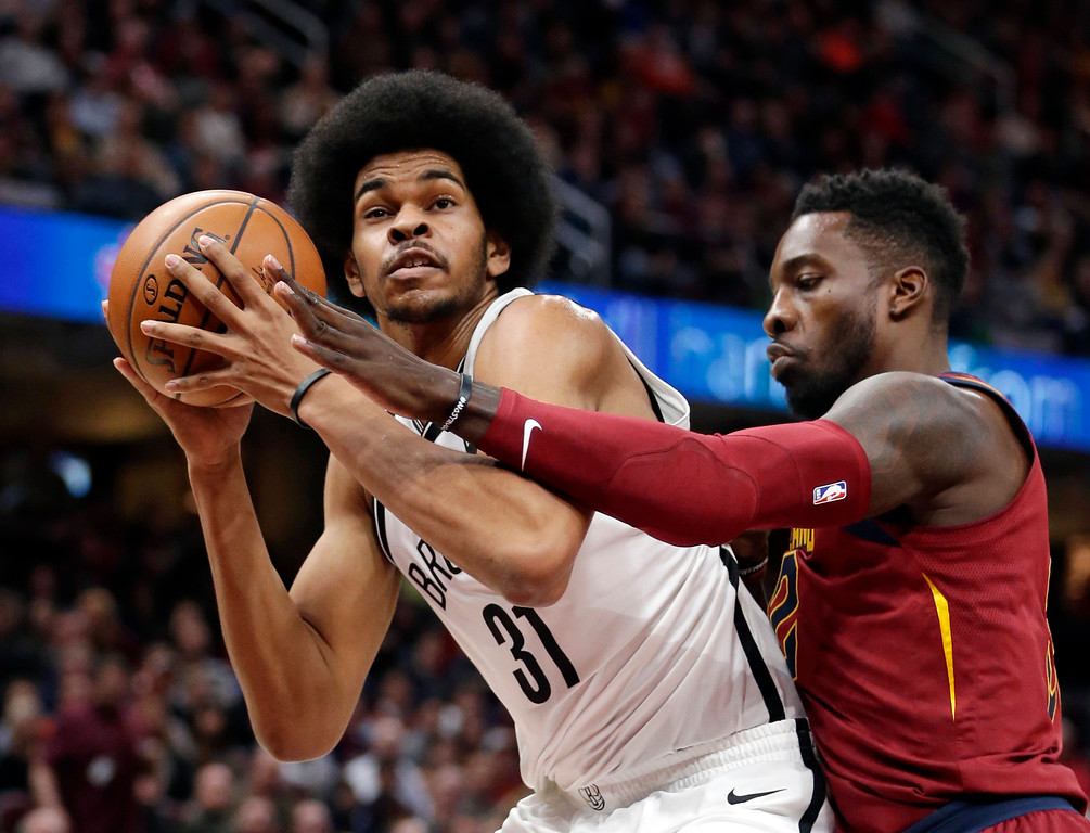 . Brooklyn Nets\' Jarrett Allen, left, drives against Cleveland Cavaliers\' Jeff Green during the first half of an NBA basketball game, Wednesday, Nov. 22, 2017, in Cleveland. (AP Photo/Tony Dejak)