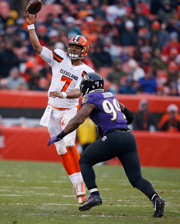 . Cleveland Browns quarterback DeShone Kizer (7) passes under pressure from Baltimore Ravens outside linebacker Matt Judon (99) during the second half of an NFL football game, Sunday, Dec. 17, 2017, in Cleveland. (AP Photo/Ron Schwane)
