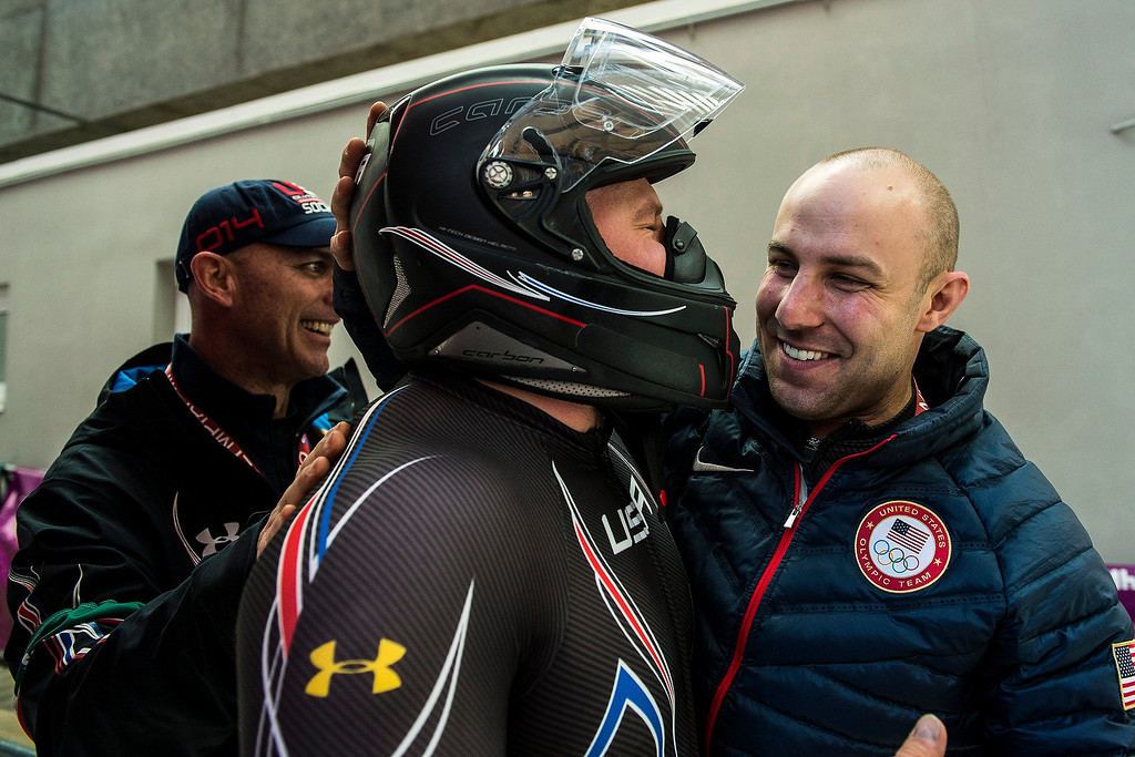 . USA\'s pilot Steven Holcomb celebrates with USA bobsled Head Coach Brian Shimer and Nick Cunningham after the four-man bobsled at Sanki Sliding Center during the 2014 Sochi Olympics Sunday February 23, 2014. They won the bronze medal with a cumulative time of 3:40.99.  (Photo by Chris Detrick/The Salt Lake Tribune)