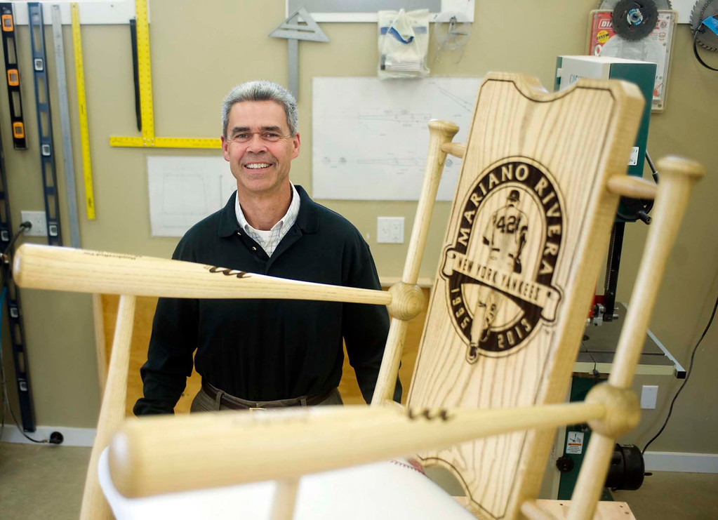 . In this Aug. 27, 2013 photo, Dan Supple, the manager of Astoria Warehousing and creator of the Supple Rocker,  poses in his home workshop in Astoria, Ore., with a custom rocker he made for New York Yankees Mariano Rivera\'s retirement ceremonies. (AP Photo/The Daily Astorian, Alex Pajunas)
