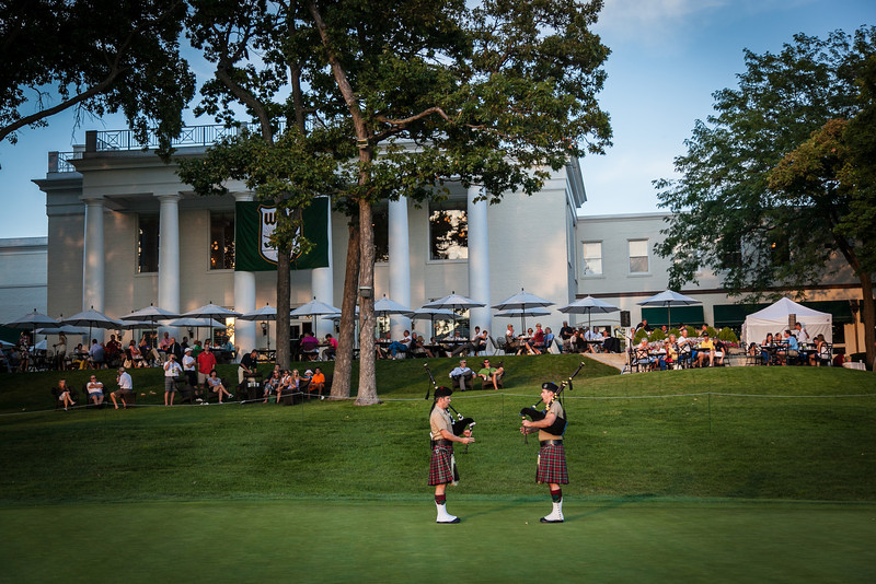 Bagpipers play on the 18th green after the end of the first day of competition at the 2012 Western Amateur Championship at Exmoor Country Club in Highland Park IL. on Tuesday, July 31, 2012. (WGA Photo/Charles Cherney)