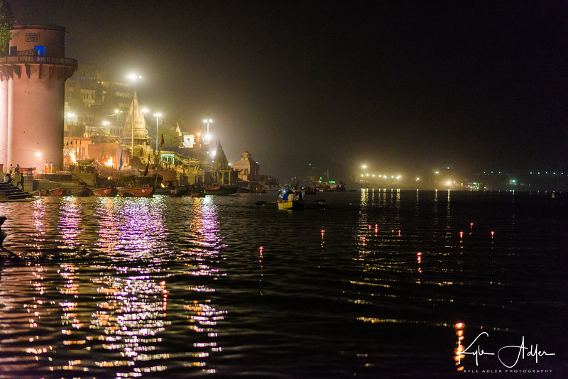 The candles lit by our group and placed over the side of the boat onto the river float gently down the Ganges.